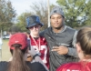 UA defensive lineman Da'Shawn Hand poses for a photo with UA Special Olympics College athlete Shawn Meadows.