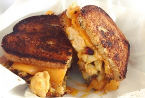 The Mac and Cheesus is a favorite among the kitchen staff. It features mac and cheese, bacon bits, and special sauce.