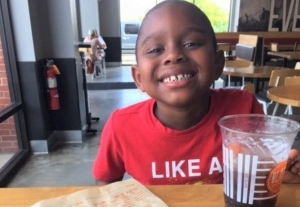 Beaux William smiles over an empty plate at Blaze Pizza in Tuscaloosa. Create-your-own restaurants give children options for healthy, fresh vegetables and fruits to go along with fun meals.