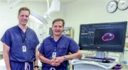 Dr. Matthew Thom (L) and Dr. Howard Winfield with the UroNav prostate imaging system.