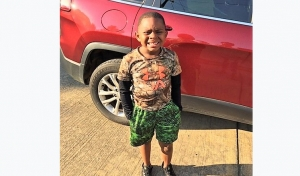 Beaux William attends his last day of kindergarten wearing his favorite camouflage shirt. He wore uniforms during the school term, so he was excited to wear street clothes on the final day.