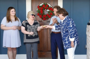 Coach Nick Saban and his wife Terry present the keys to the 17th Habitat for Humanity of Tuscaloosa home built by Nick's Kids Foundation to Donna Smith on May 3.