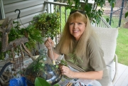 Tuscaloosa Master Gardener Pam Sloan works on terrariums at home.
