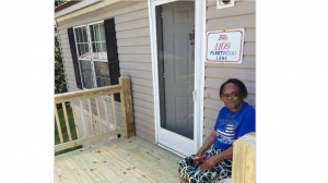 Bernell Bostic sits on her porch, built by Habitat for Humanity.