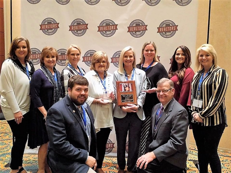 "The Tuscaloosa Association of Realtors won several awards at the ARPAC & Advocacy Awards luncheon, held during the Alabama Association of Realtors Capitol Conference in Montgomery in February, including the 100 Percent of ARPAC Goal Award, the Call for Action Participation Goal Award, and the Robert C. ""Bob"" Meeks 2016 ARPAC Award. Pictured are (L to R, Front Row): Chris Lee and Tom Owings. (L to R, Back Row): Melanie Foster, Donna Petty, Vanessa Lockhart, Dedra Cabaniss, Katherine Manderson, Shay Lawson, Julie Cook, and Chelsea Carnes."