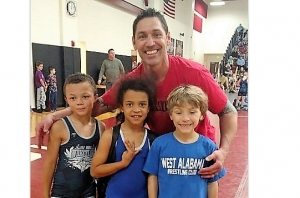 Robert Kronable with some of his young wrestlers (L to R) Garrett Ferguson, Reece Glasgow, and his son, Liam Kronable.