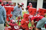 Tide veteran Defensive Line Coach Bo Davis conducts drill work with several UA players.