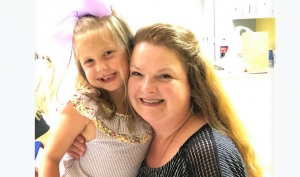Alicia Jenne' (shown here with PreK grad Lynley) is a veteran teacher of little people and is the PreK Pals Lead Teacher for PreK#1 at Rock Quarry Elementary School in Tuscaloosa.
