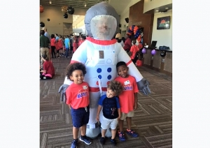 "Beaux William (right) and his friends (from left to right), Sam and Silas Barrett, pose with an astronaut on the first morning of camp. Church of the Highlands' annual summer camp, ""Summer Blast,"" had a 2018 theme of ""Outta this World."""