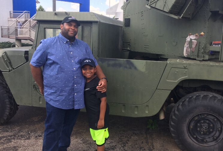 Beaux William and his dad, Roderick, posing in front of a United States Military vehicle at the U.S. Space and Rocket Center in Huntsville.