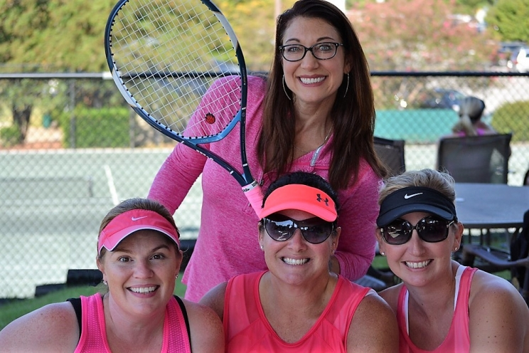 "Dana Duckworth (back), from left – Elizabeth Bearden, Peggy Ball and Julie Smith at ""A Day on the Courts."""