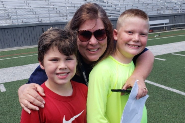 Teacher Sheila Hallman with two of her past students during a field day.