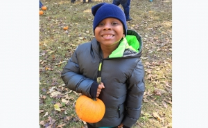 Beaux William picks pumpkins at Helena Hollow. During the holidays, taking the kids out for local, holiday-themed adventures can provide sweet family time and keep children busy when school is out.