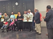 Dr. Walter Davie accepts a special piece of art work from Sprayberry students, staff, and families on March 23.