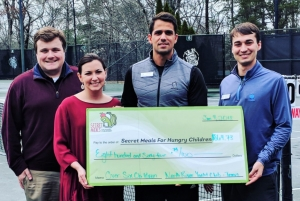 (L to R): Keith Swafford and Kelley Porter, representing Alabama Credit Union and Secret Meals accept a check from NorthRiver Yacht Club representatives Igor Santos and George Tucci.