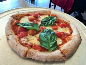 Post Office Pies' Margherita pizza features house-made mozzarella, fresh basil, roasted cherry tomatoes and parmesan.