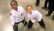 Beaux William at a karate tournament with his friend, Sam Barrett.