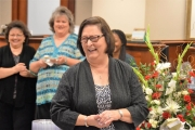 Mary Nell Hallman shares laughs with Bryant Bank colleagues during a ceremony honoring her retirement.