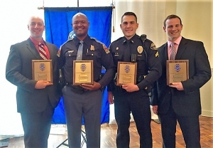 The 2018 Law Enforcement Officers of the Year are (L to R): Deputy Brad Flowers (Tuscaloosa Sheriff's Office), Senior Trooper Johnny Clark (Alabama Law Enforcement Agency), Corporal Jake Johnston (City of Tuscaloosa Police Department) and Investigator Jeffery Miller (Northport Police Department).   Officer Brad Thomas (University of Alabama Police) was not able to attend the meeting.