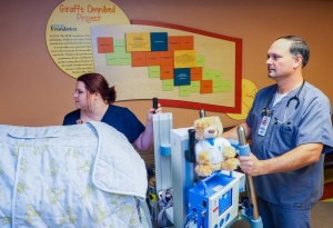 Cassidy Simpson, Registered Nurse, (L) and David Miller, Respiratory Therapist, demonstrate one of the two portable ventilators for critically ill infants at DCH Regional Medical Center and Northport Medical Center. The ventilators where purchased by a grant from Brave Beginnings, a program of the Will Rogers Motion Picture Pioneers Foundation.