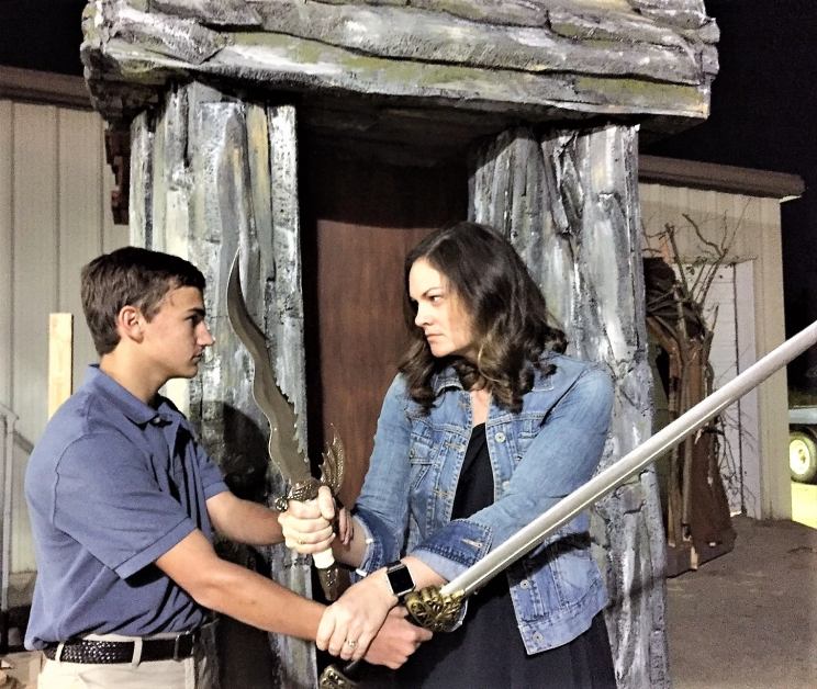 Caleb Burdette (Edmund Pevensie) and Mary Kathryn Matthews (the White Witch) size each other up before rehearsing their intricate stage combat.