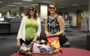 University Libraries' Hannah Hatter and Emily Burnett are busily preparing for the solar eclipse event on Monday, Aug. 21.
