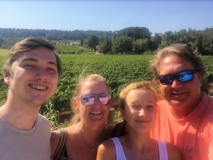 "With ""la mia famiglia"" – including my son, Brent, daughter, Ann Kathryn, and husband, Chad – during our recent trip to Italy. We reconnected, and were reminded to take some time, relax, and enjoy the beauty around us."