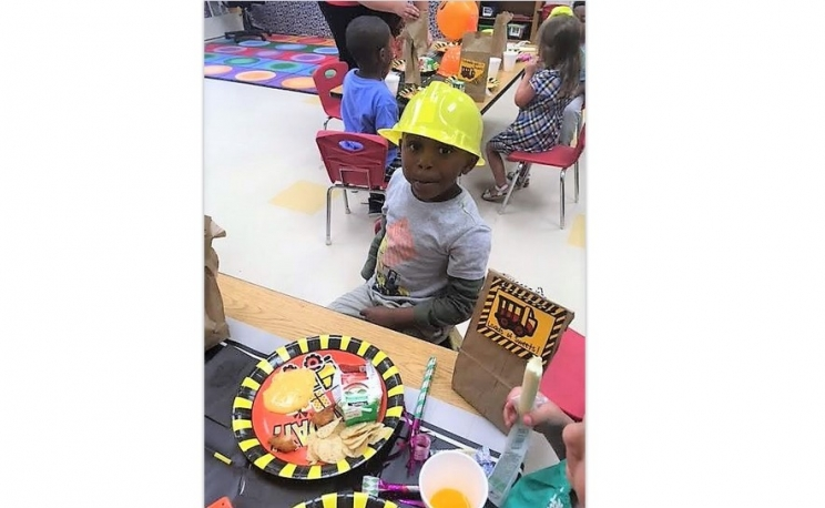 Beaux William taking a break from the festivities during his construction birthday party. Incorporating your child's party in school is a great way for a mom to become more involved with the goings-on of class.