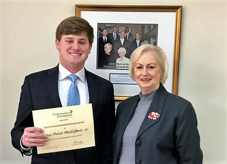 UA student Price McGiffert, Jr. receives the Community Foundation of West Alabama's Elois Zeanah Scholarship from Jackie Ray. Ray is a member of the Republican Women of Tuscaloosa County.