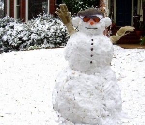 A snowman greets passersby after a light snow in 2009.