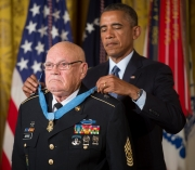 President Barack Obama bestows the Medal of Honor to retired Command Sgt. Maj. Bennie G. Adkins in the East Room of the White House, Sept. 15, 2014.