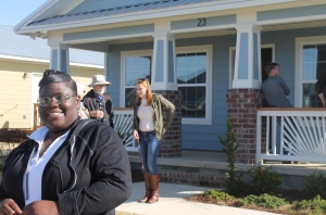 Monique Hubbard stands proudly in front of her new Habitat Tuscaloosa home on Nov. 20.