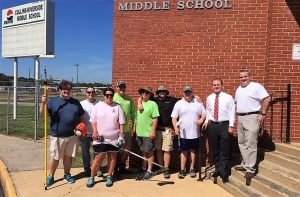 Regions employees spend the day cleaning up and completing various much-needed projects at Collins-Riverside Middle School on Aug. 24.