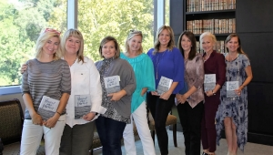 Each week, a group of Tuscaloosa realtors gathers for a small book group at Rosen Harwood. (L to R): Kim Hargrove, Debbie Puckett, Danita Mims, Carrie Fitts, Amanda Jones, Tammy Regevig, Leesha Shotts and Allison Adams.