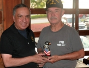 "Nicolas Britto (left), AUSA President Tuscaloosa Chapter, presents Walter Turner with the ""Patriotism Award."""