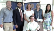 Exchange Club of Tuscaloosa Grant Recpients are (Front) McClaine Burleson, United Cerebral Palsy; (Standing L to R) Derek Osborn, PRIDE; Tyler Merriwether and Pam Parker, Boys & Girls Club; Arthenia Lewis, King's Home; and Jean Rykaczewsky, West Alabama Food Bank.