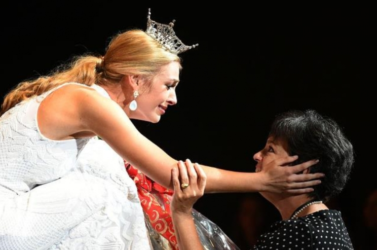 Miss Alabama, Callie Walker, shares a touching moment with her mother, Angela Tower Walker (Miss Alabama 1985), shortly after being crowned.