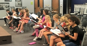 Cast members in Tuscaloosa Children's Theatre's upcoming production of Annie Jr. read through their lines during rehearsal.