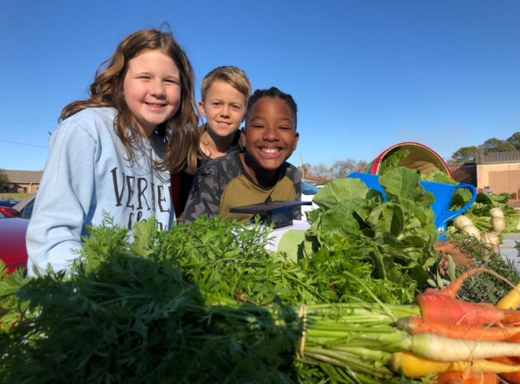 Local Nonprofit Schoolyard Roots Holds Farm Stands with Elementary Students