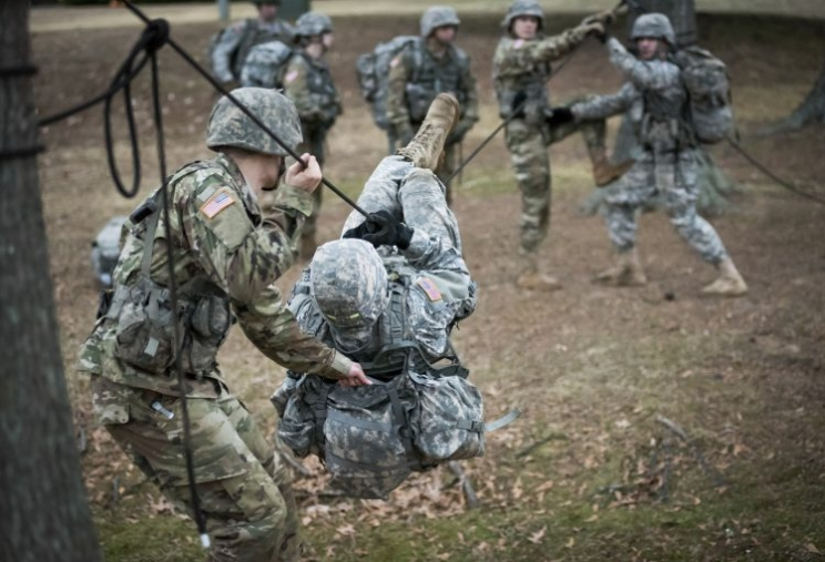 UA's Ranger Challenge team practices a one-rope bridge prior to last year's Sandhurst competition.
