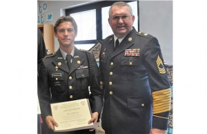 Army JROTC Cadet Jacob Fitzpatrick (left) receives the Scottish Rite Americanism Award from retired Alabama National Guard Master Sergeant Ron Anders during Hillcrest High School's awards ceremony.