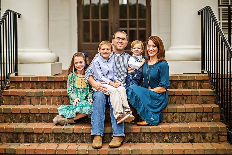 Jason Bacak (center) with children (L to R) Laura Kate (8), Thad (7), Rhett (18 mos.) and wife Brooke.
