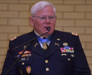 Congressional Medal of Honor Recipient Capt. Gary M. Rose, U.S. Army, Retired, addressing the audience at the Association of the U.S. Army, West/Central Alabama Chapter luncheon on December 4, 2017, at the Tuscaloosa Rivermarket . President Donald Trump presented the Congressional Medal of Honor to Rose on October 23 at the White House.