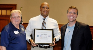 Jack McNair, ESGR Representative; Chief Anderson, and Tuscaloosa Mayor Walt Maddox during the award ceremony held on July 24 at Tuscaloosa City Hall.