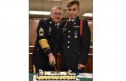 Retired Ala National Guard Master Sergeant Ron Andress and Cadet Preston Reynolds cutting the traditional Army cake during the Army birthday last year.