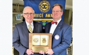 Bob Shaw (L), the 2018 Book of Golden Deeds honoree, receives his award from the Exchange Club of Tuscaloosa's Evans Fitts on Nov. 29.