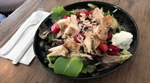 Real & Rosemary's Upbeet Salad features an array of red and yellow beets, along with almonds, fresh fruit, goat cheese, and a tarragon vinaigrette. An addition of grilled chicken provides some extra protein to this refreshing salad.